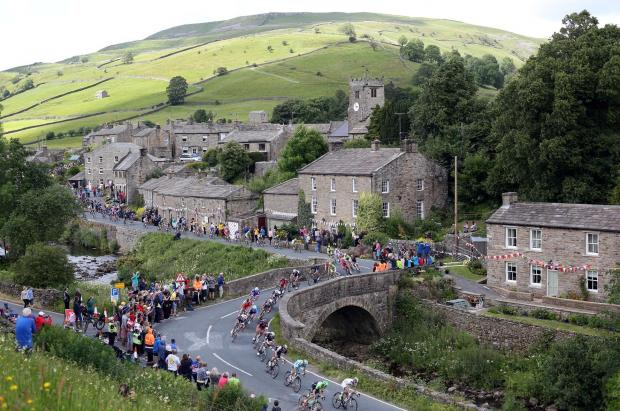 The Advertiser Series: RACE DAY: The cyclists at Muker as stage one of the Tour de France passes through Swaledale, North Yorkshire.  Picture: CHRIS BOOTH