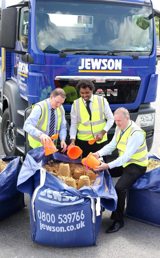 The Advertiser Series: BUILDING SAND CASTLES: Jewson are supplying the sand for this year's 'Darlington by the Sea' event which takes place in the town's market square at the end of July.  Pictured at the company's Valley Road site are Jewson general manager