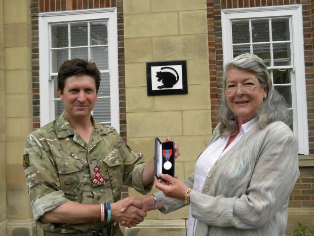 The Advertiser Series: LOYAL SERVICE: Brigadier Charlie Herbert presenting the Imperial Service Medal to Elizabeth House outside Baden-Powell House, the headquarters of 4 Mechanized Brigade.