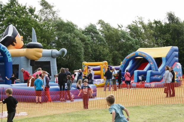 The Advertiser Series: Fun on the inflatables at village festival