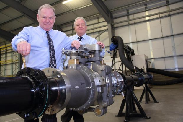 The Advertiser Series: MAJOR EXPANSION: Geoff Turnbull, GT Group chairman, left, and John Lamb, Alpha Process Controls' managing director, with a testing unit