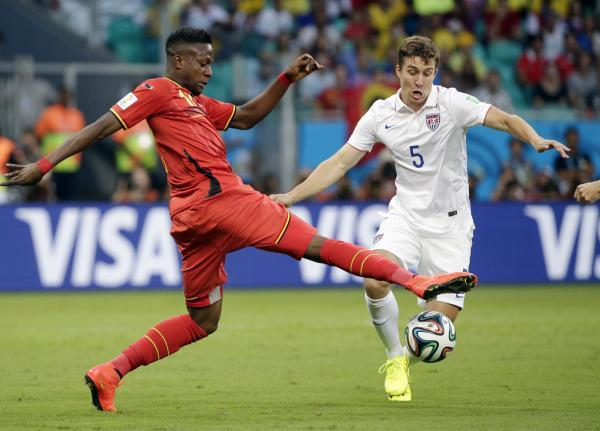 The Advertiser Series: IN DEMAND: Defender Matt Besler, right, pictured playing in the World Cup against Belgium, says Sunderland and Fulham are interested in him