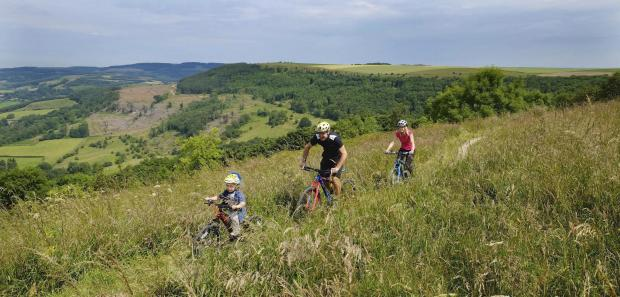 The Advertiser Series: RIDING HIGH: Seth Baum, four, Adrian Carter and Nicola Richardson test one of the new trails near Sutton Bank – Picture: Tony Bartholomew