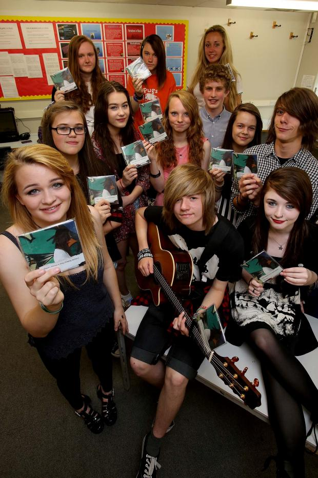 The Advertiser Series: : Singer songwriter Emily Smith (14, front/left) with guitarist Jack Mylchreest (15) with fellow students from Park View School who have created a charity single to help raise money for If U Care Share. Picture: DAVID WOOD (8379090)