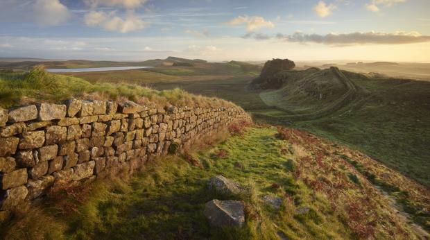 The Advertiser Series: Hadrian's Wall near Housesteads. A section of the historic Roman stone wall fortification in Northern England started in AD 122. A UNESCO world heritage site. Sunrise or dusk. (8375577)