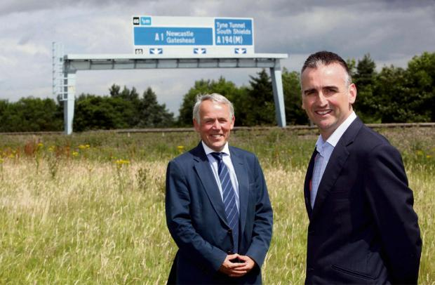 The Advertiser Series: TRADE DEAL: Paul Woolston, chairman of the North East Local Enterprise Partnership, left, with Geoff Clark, of Ravensworth Property Developments, at the site of Portobello Trade Park