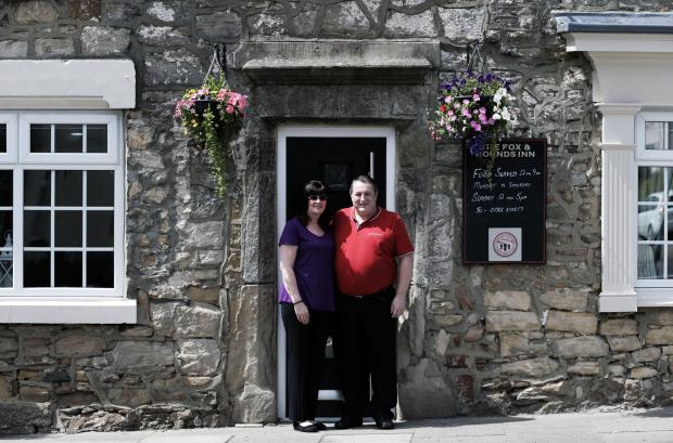 The Advertiser Series: PUB REOPENS: Steve Metcalfe and Lynda Harland outside The Fox and Hounds Inn 	Picture: STUART BOULTON