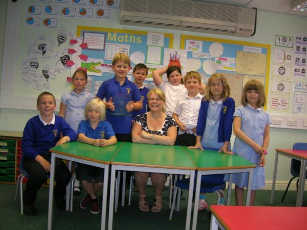 The Advertiser Series: Profitable school: Head teacher Christine Gabbott with money making  pupils at Pickhill Primary