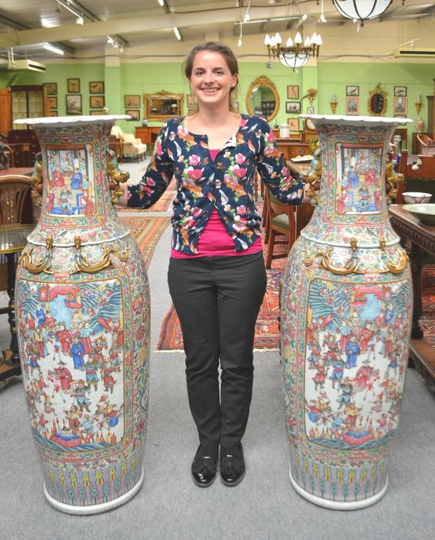 The Advertiser Series: DRAMATIC PIECES: Auction assistant Robyn Alderson with the Cantonese vases, which will go up for auction at Tennants Auctioneers