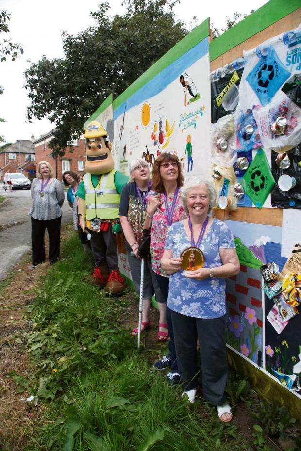 The Advertiser Series: ART WALL: Artists whose work has brightened up hoardings at The Elms in Chester-le-Street get their award from mascot Ivor Goodsite, centre. Artists, from left June Turner, Norma Menzies, Pauline Thompson, Christine Borthwick, Rose Lockey and Beryl Ri