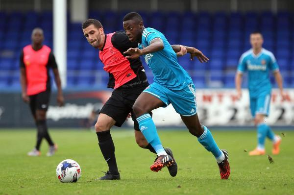 The Advertiser Series: IN THE PINK: Hartlepool United's Stuart Parnaby, left, and Sunderland's El-Hadji Ba during the Black Cats' 3-0 win at Victoria Park last night