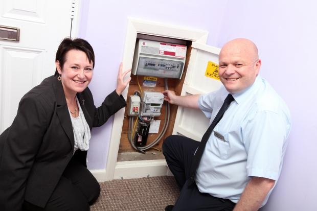 The Advertiser Series: NEW METERS: Vicky McCourt and Trevor Smith, both Derwentside Homes, inspect one of the smart