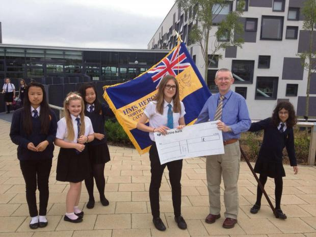 The Advertiser Series: HEROES BADGE: Grace Maddison-Potts with HMS Heroes' representatives presenting a £6