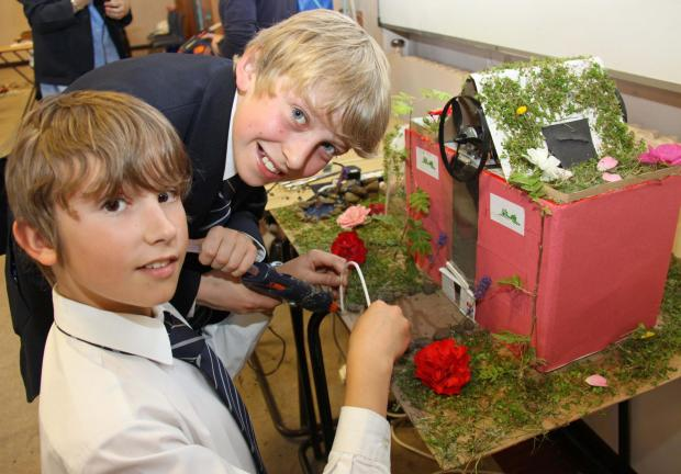 The Advertiser Series: ECO-CHALLENGE: Ralph Lockey (left) and Harry Canning put the finishing touches to their team's design at Ripon Grammar School'