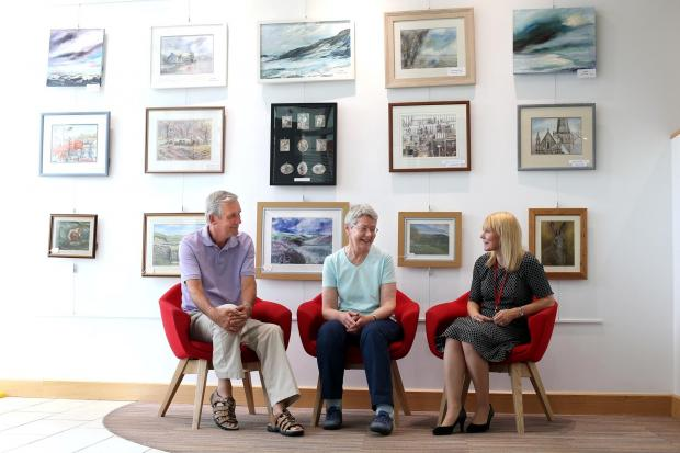 The Advertiser Series: IN THE PICTURE: Darlington Building Society in Darlington town centre is hosting an exhibition of work by members of Darlington Society of Arts (DSA).  Pictured by the exhibition are Colin Farrant of DSA, Gina Morton of DSA and an exhibitor, and Sharon Wi