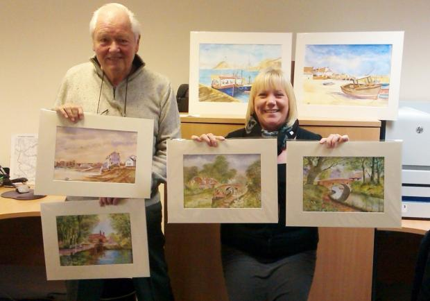 The Advertiser Series: ART AWARD: Ken Tooby with Amy Waite, of the Stroke Association, shows off his artwork