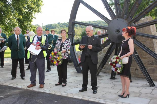 The Advertiser Series: North Skelton Band master Denis Noble, Coxhoe Banner Group chairman Robert Robinson, secretary Jenny Robinson, Rev Christopher Wood-Archer and Councillor Maria Plews in front of the Coxhoe mining memorial (8789989)