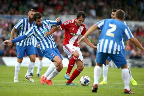 The Advertiser Series: Impressive: Kike is stopped by Pools defender Matthew Bates