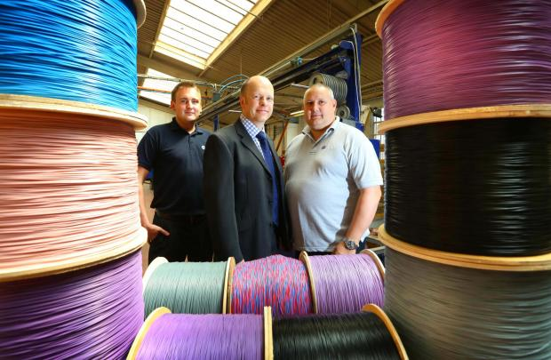 The Advertiser Series: CABLE TIES: David Thomas, of NEL Fund Managers, centre, with David Hazeldine, Atag's business development manager, left, and managing director Andy Graham