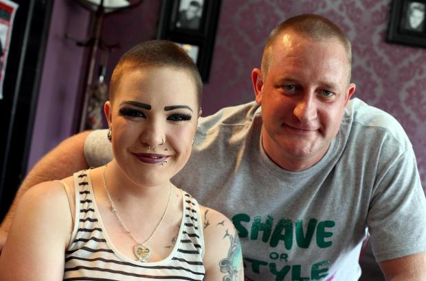 The Advertiser Series: HEADS UP: Barber Darrel Johnson (right) and Paige Harker have had their heads sha