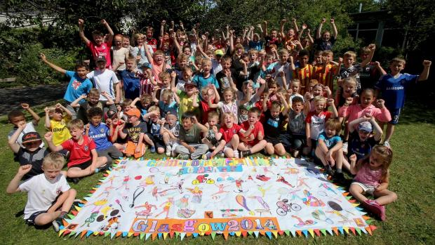 The Advertiser Series: : Members of the Durham Gilesgate Youth Community Association with their Commonwealth Games flag during their summer sports camp at Durham Free school in Gilesgate. Picture: DAVID WOOD (8618037)