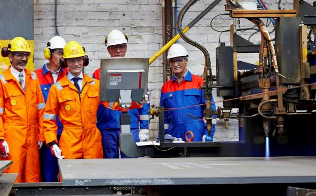 The Advertiser Series: Jan Willem Verkaik, project director from Shell (third left), presses the button to make the first cut of steel at OGN Group on the Nyhamna project