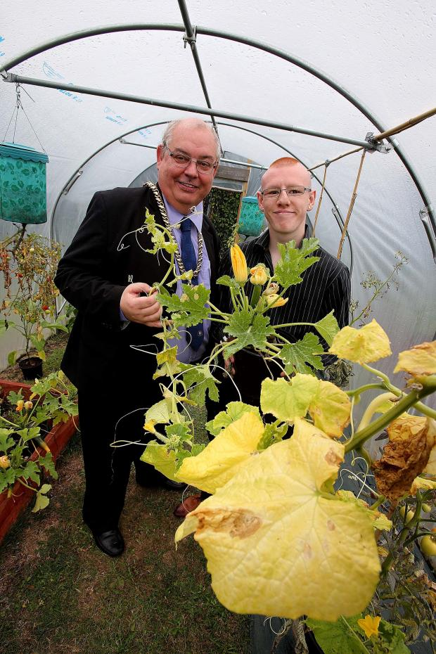 The Advertiser Series: : The Mayor of Durham, councillor John Robinson talks with service user Charlie Tyson (18, right)  following the official opening of the new Together Garden and Allotment at Lanchester Road Hospital in Durham. Picture: DAVID WOOD (8859429)