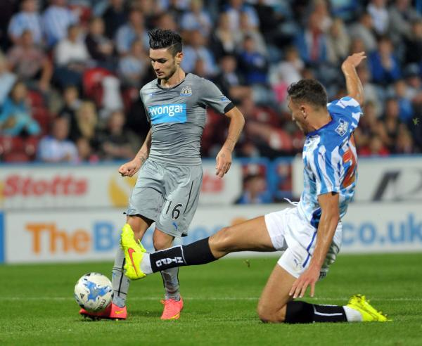 The Advertiser Series: STYLISH: Remy Cabella deftly dinks the ball home to ensure a 2-2 draw at Huddersfield last night