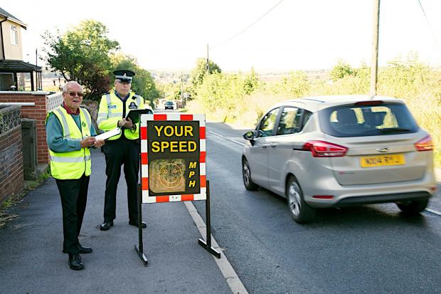 The Advertiser Series: SPEED CHECK: PCSO Brian Nicholson, with volunteer Neil Pennington, check vehicle speeds in Kirk Merrington. Picture: KEITH TAYLOR