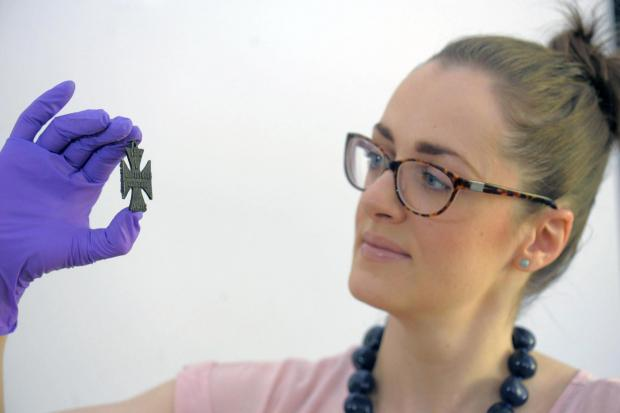The Advertiser Series: PROPAGANDA  SPOOF: Jennifer Dunne, collections manager for Scarborough Museums Trust ,with the First World War propaganda Iron Cross.