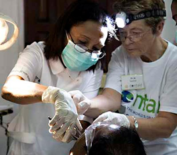 The Advertiser Series: HELPING HAND: Jo Daly, right, during her visit to Timore Leste with the charity Dentaid