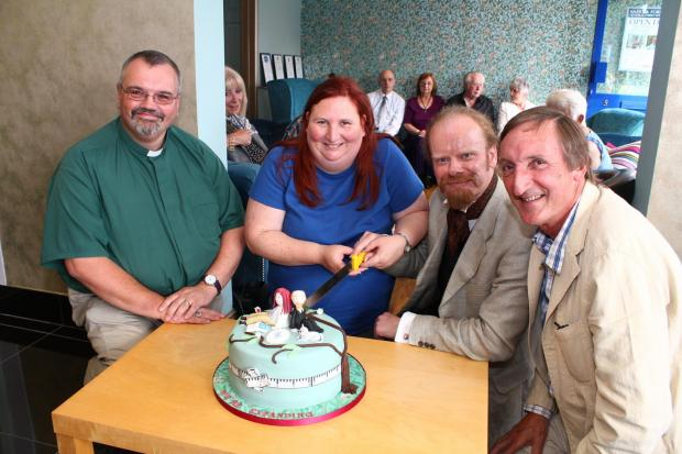 The Advertiser Series: OPEN DAY: Keith Munt and Jenny Uzzell (centre) cut the celebration cake at Saint and Forster's open day, watched by the Rev George Calla