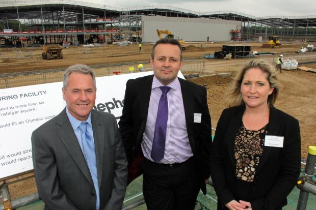 The Advertiser Series: John and Julie Finley with Shepherd Construction's regional managing director Andrew Constantine (centre) on the Hitachi site in Newton Aycliffe.