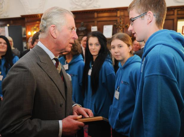 The Advertiser Series: ROYAL EVENT: The Prince of Wales receives a plaque from a member of the High Tide Foundation during his visit to the offices of PD Ports last year. PD Ports operates Tees Dock, which is the hub of activity at Teesport