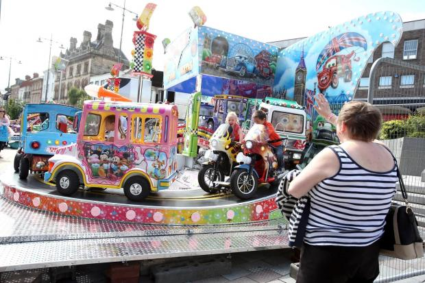 The Advertiser Series: MARKET EXTRAVAGANZA: Fairground rides at Joseph Pease Place, Darlington prior to the start of the annual summer markets being erected in the town centre.  Picture: CHRIS BOOTH