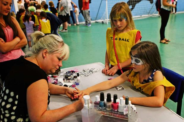 The Advertiser Series: 50th ANNIVERSARY: Auckland Youth and Community Centre celebrate 50th birthday. Pictured, Ellie and Hollie Woodhams having their nails painted by Lynsey Bowes. Picture:SARAH CALDECOTT