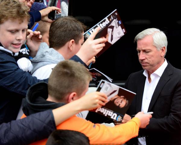 The Advertiser Series: KEEPING QUIET: Alan Pardew signs autographs before yesterday's game - but he did not speak to the media afterwards.