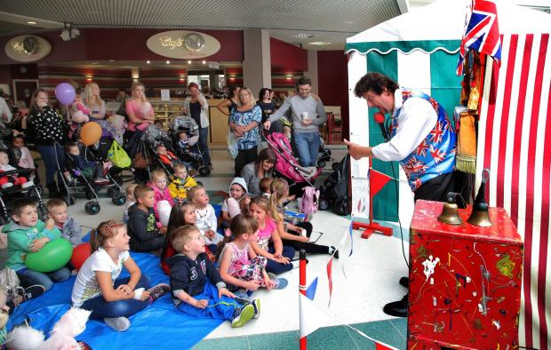 The Advertiser Series: FUN TIME: Brian Llewellyn entertains children at a seaside-themed event in Darlington's Cornmill shopping centre. Picture: ANDY LAMB