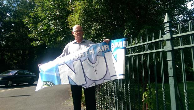 The Advertiser Series: BANNER VANDALISED: David Gibson, of GNAAS, with the banner
