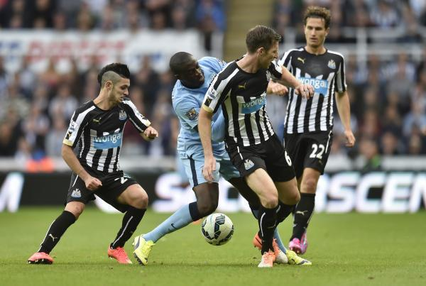 The Advertiser Series: Thwarted: Yaya Toure is stopped by Remy Cabella and Mike Williamson