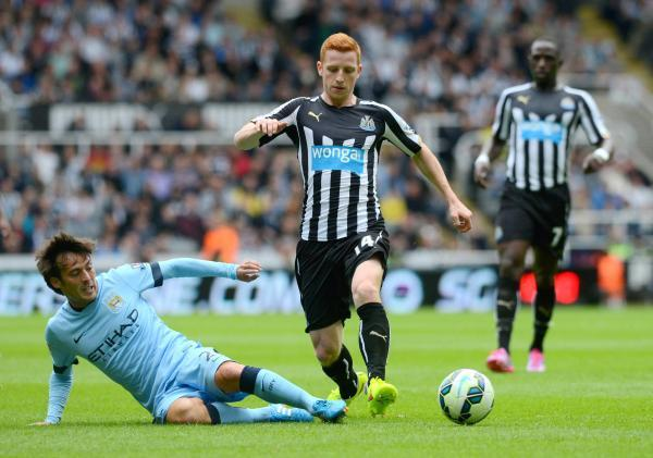 The Advertiser Series: SILVA LINING: New signing Jack Colback, who moved to Newcastle from Sunderland on a free transfer, is tackled by David Silva