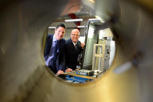 The Advertiser Series: AMBITIOUS PLANS: Matthew Elliott (left), Barclays relationship director, with Peter Coates, managing director of Durham Precision Engineering