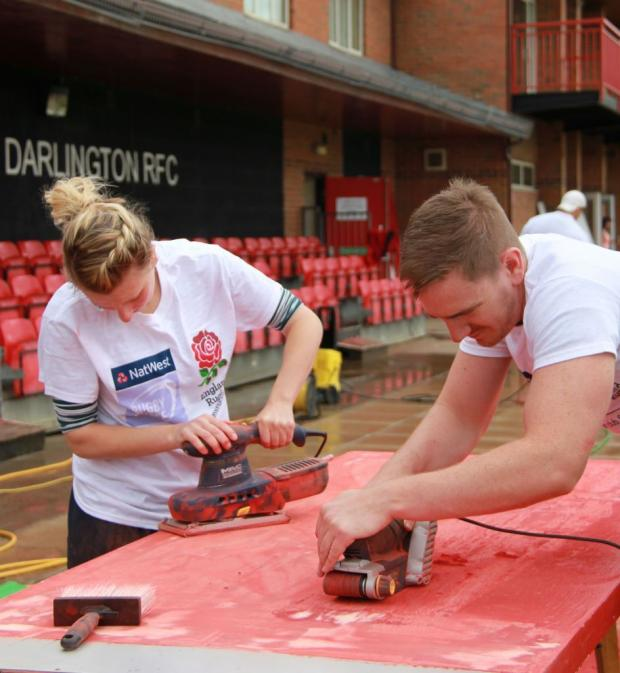 The Advertiser Series: TRY HARD: Volunteers get their hands dirty at Darlington Rugby Club Picture: DAVID BRIDGEN/CLIQUE IMAGES