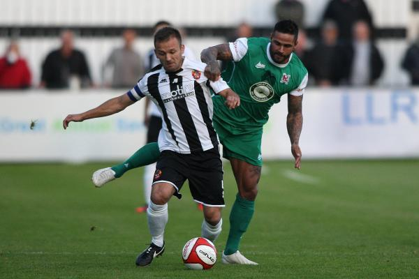 The Advertiser Series: DERBY BATTLE: Spennymoor's Lewis Dodds is put under pressure by Darlington's Leon Scott