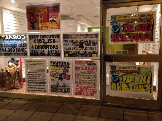 The Advertiser Series: UNITED FRONT: Posters in the front window of DLA headquarters
