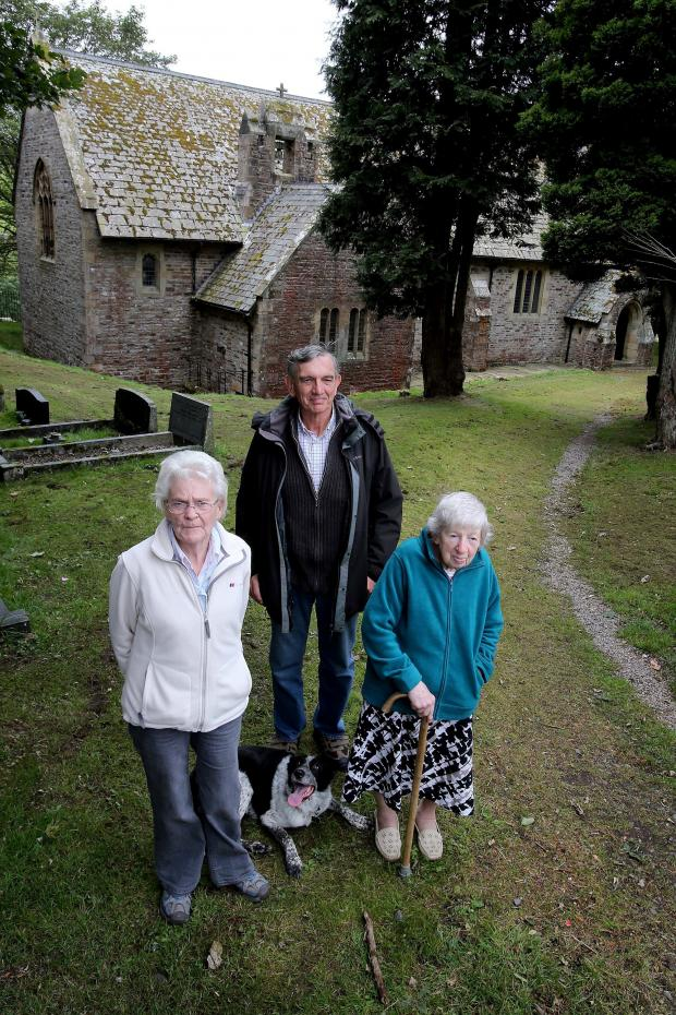 The Advertiser Series: PATH REPAIRS: Parishioners Jim Bowen, Lillian Rutherford (r) and Anne Rutherford (l) outside St Thomas Heatherycleugh Church in Cowshill. Picture: DAVID WOOD