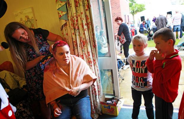 The Advertiser Series: HAIR SHAVE:Tracey Kieran, a carer at Willow Green Care Home, in Darlington, has her head shaved as part of a fundraising party at the home Picture: SARAH CALDECOTT