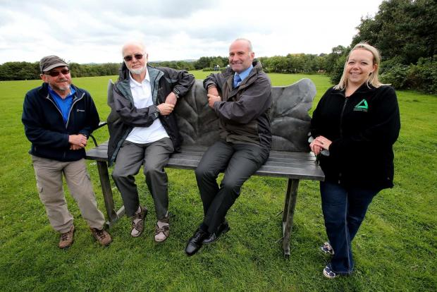 The Advertiser Series: : Artist Jim Roberts (left) with Colin Reynolds from the Pelton Fell Community Partnership, Steven Craig, Clean and Green manager from Durham County Council and Lynne Miller, Senior Projects Officer from Groundworks (right) with one of the new benches as
