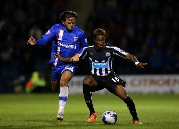 The Advertiser Series: Newcastle United's Rolando Aarons, (right) battles for the ball with Gillingham's Bradley Dack, (left)