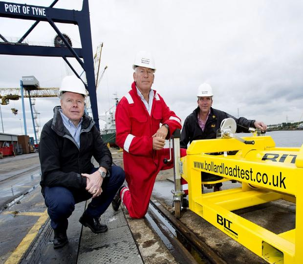 The Advertiser Series: PULLING TOGETHER: Pictured from left to right with the Bollard Load Test device are Alan Hewett, of the Manufacturing Advisory Service, Jeff Main, director of Ty